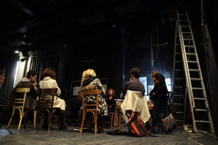 Figure 1b. Workshop and talk about the commons taking place at the main stage of the theater during the activation of Empros by the Mavili initiative in 2011. Photograph by Eleni Tzirtzilaki.