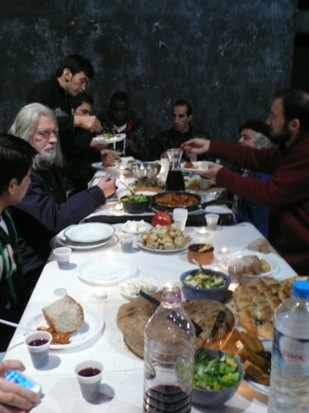 Figure 2. A communal Christmas meal in 2013 taking place in the stage of the theater . Photograph by Eleni Tzirtzilaki.